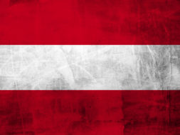 Grunge Austria flag on concrete wall