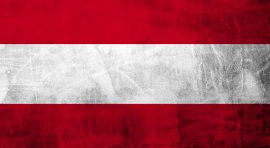 Grunge Austria flag on concrete wall