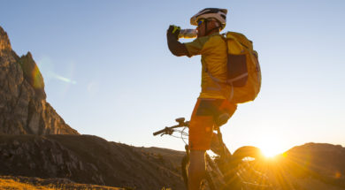 Mountain bike athletes drinking energy drink
