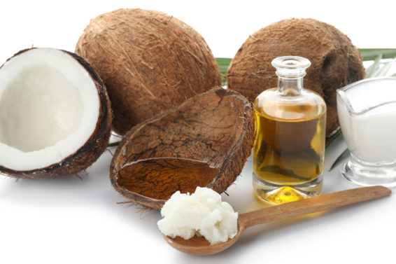 Composition with coconut oil on white background