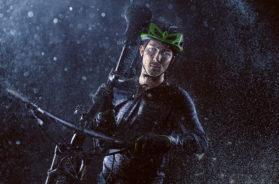 Mountainbiker carries his bike through the rain