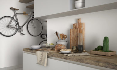 Minimalist modern kitchen close up with healthy breakfast, contemporary white and wooden interior design