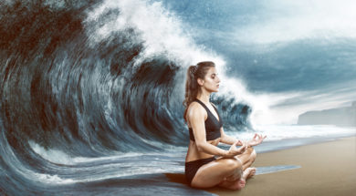 Woman relaxes in front of big wave