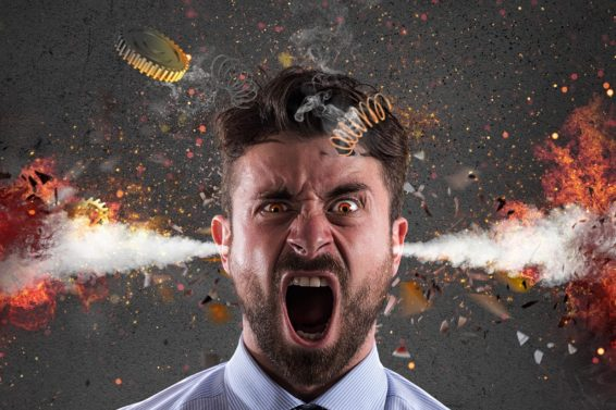 Head explosion of a businessman. concept of stress due to overwork