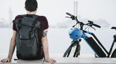 back-view-man-sitting-next-to-his-e-bike