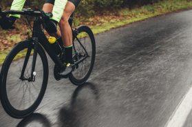 Cyclist training outdoors on a rainy day